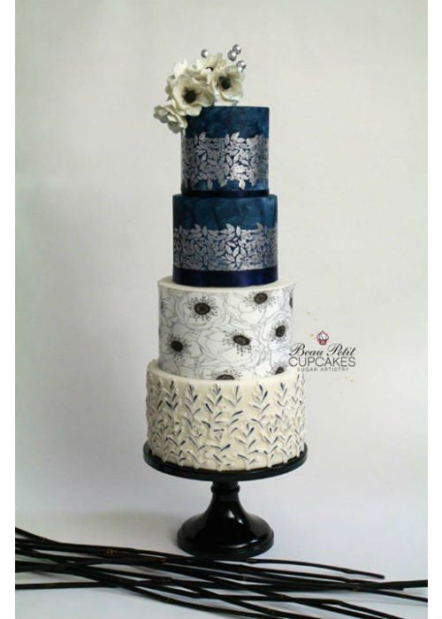 Beautifully Designed Wedding Cake on a 14 inch Black Cake Stand