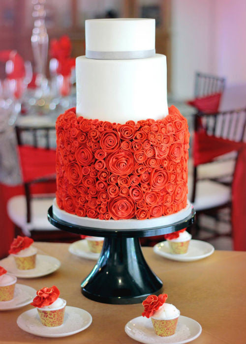 Orange Floral Cake on a 14 inch Black Cake Stand