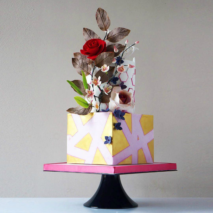 Pink and Gold Geometric Cake on 16 inch Black Cake Stand