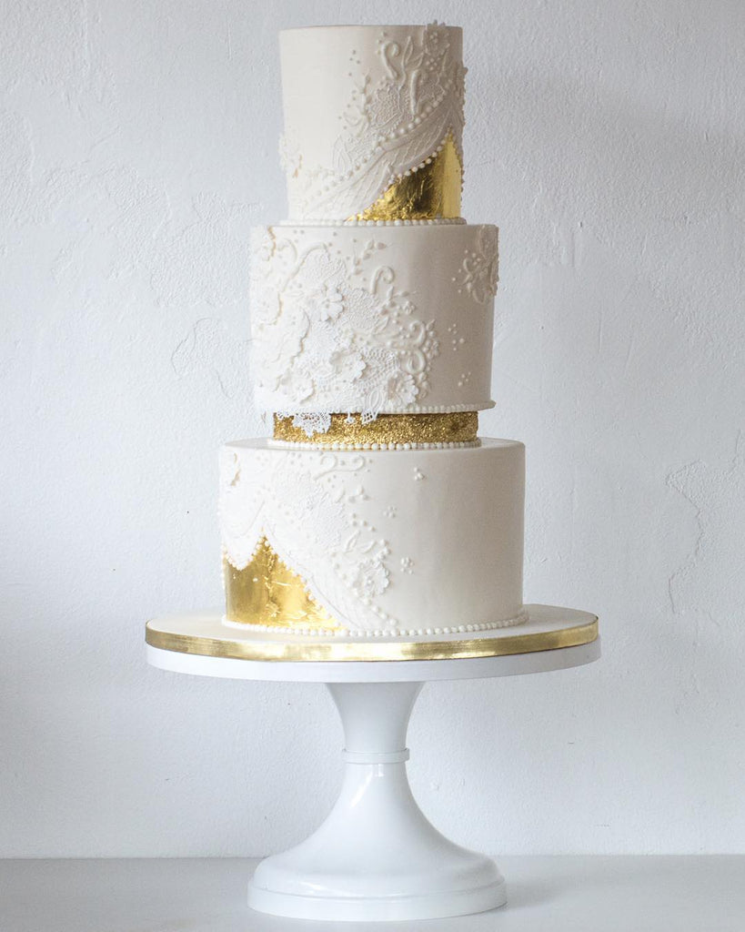 Intricate White and Gold Cake on 14 inch White Cake Sand