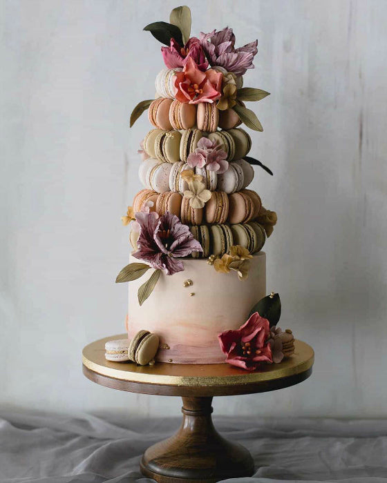 Towering Cake Topped with Macaroons on 14 Inch Natural Wood Cake Stand