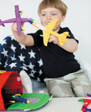 boy pretend play with toy airplanes