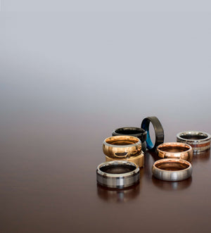 eight-mens-wedding-bands-on-a-table-shot