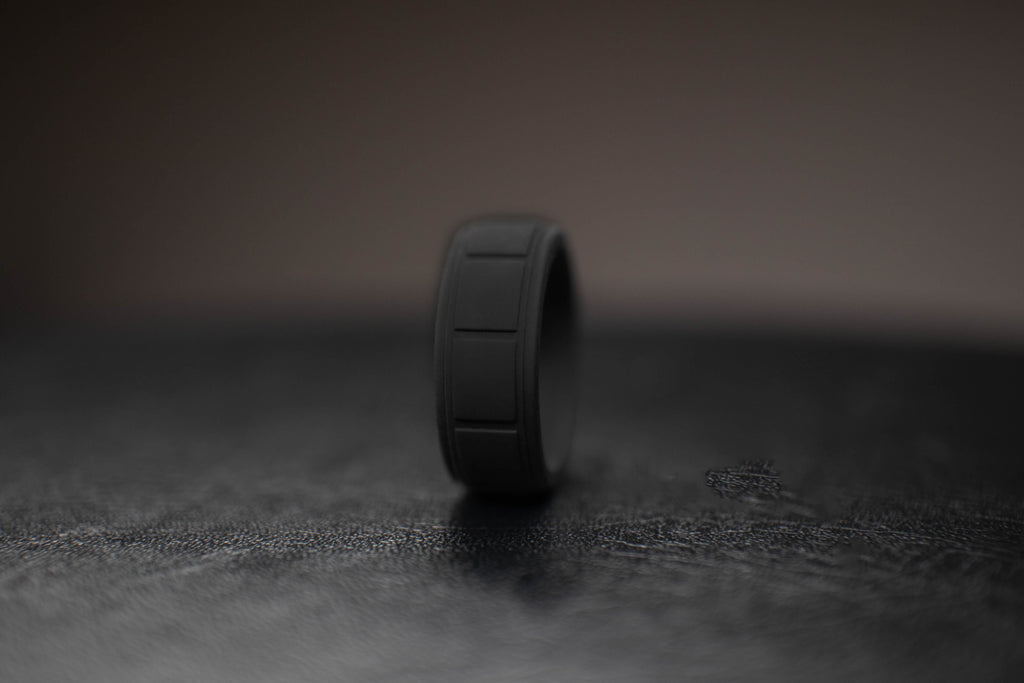 black-mens-silicone-wedding-band-dark-background