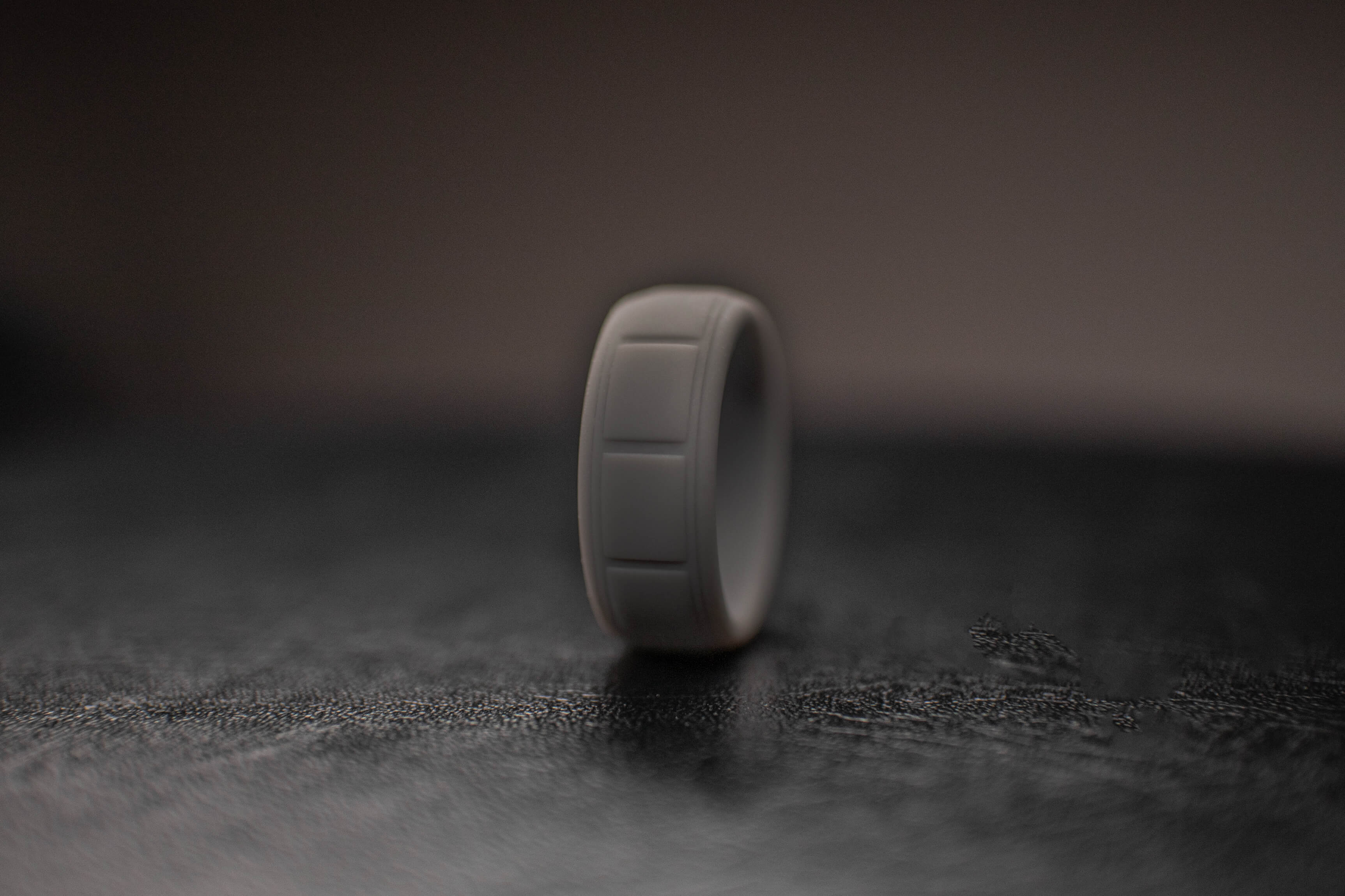 dark-gray-gunmetal-silicone-mens-wedding-band-dark-background