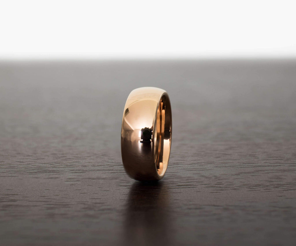 rose-gold-classic-mens-tungsten-wedding-band-on-table-with-slight-angle