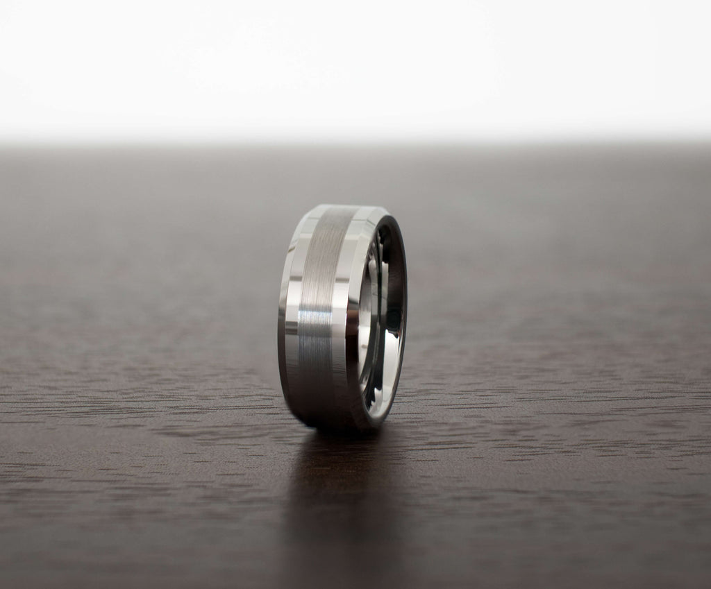 silver-brush-tungsten-carbide-mens-wedding-band-on-table-slight-angle