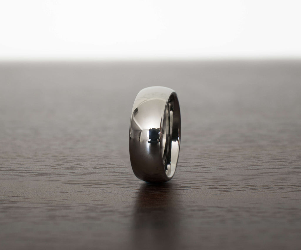 silver-classic-tungsten-carbide-men-wedding-band-on-table-slight-angle