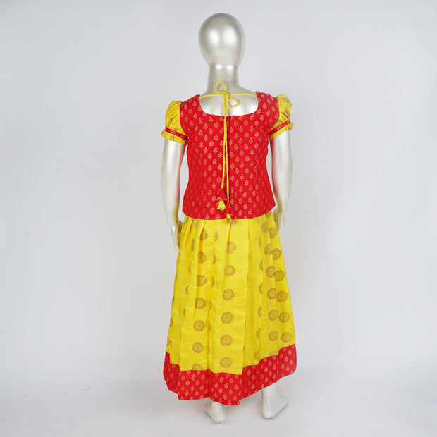 Striking Pattupavadai / Lehenga Traditional Brocade Yellow Peach Dress for Kids - thenesavu