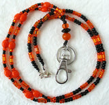 Black orange beaded badge holder