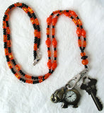 black orange watch holder lanyard