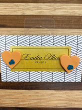 Load image into Gallery viewer, Emilia Alice Designs - Clay Earrings - Orange Heart with Teal Detail - Studs