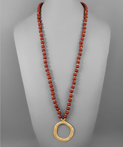 Red Wooden Beaded Necklace with Gold Hammered Circle