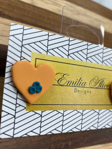 Emilia Alice Designs - Clay Earrings - Orange Heart with Teal Detail - Studs