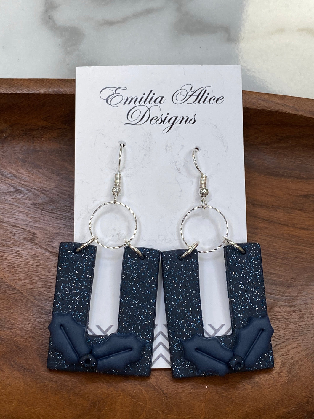Emilia & Alice Designs - Clay Earrings - Navy Glitter Horseshoe with Holly Leaf Accent