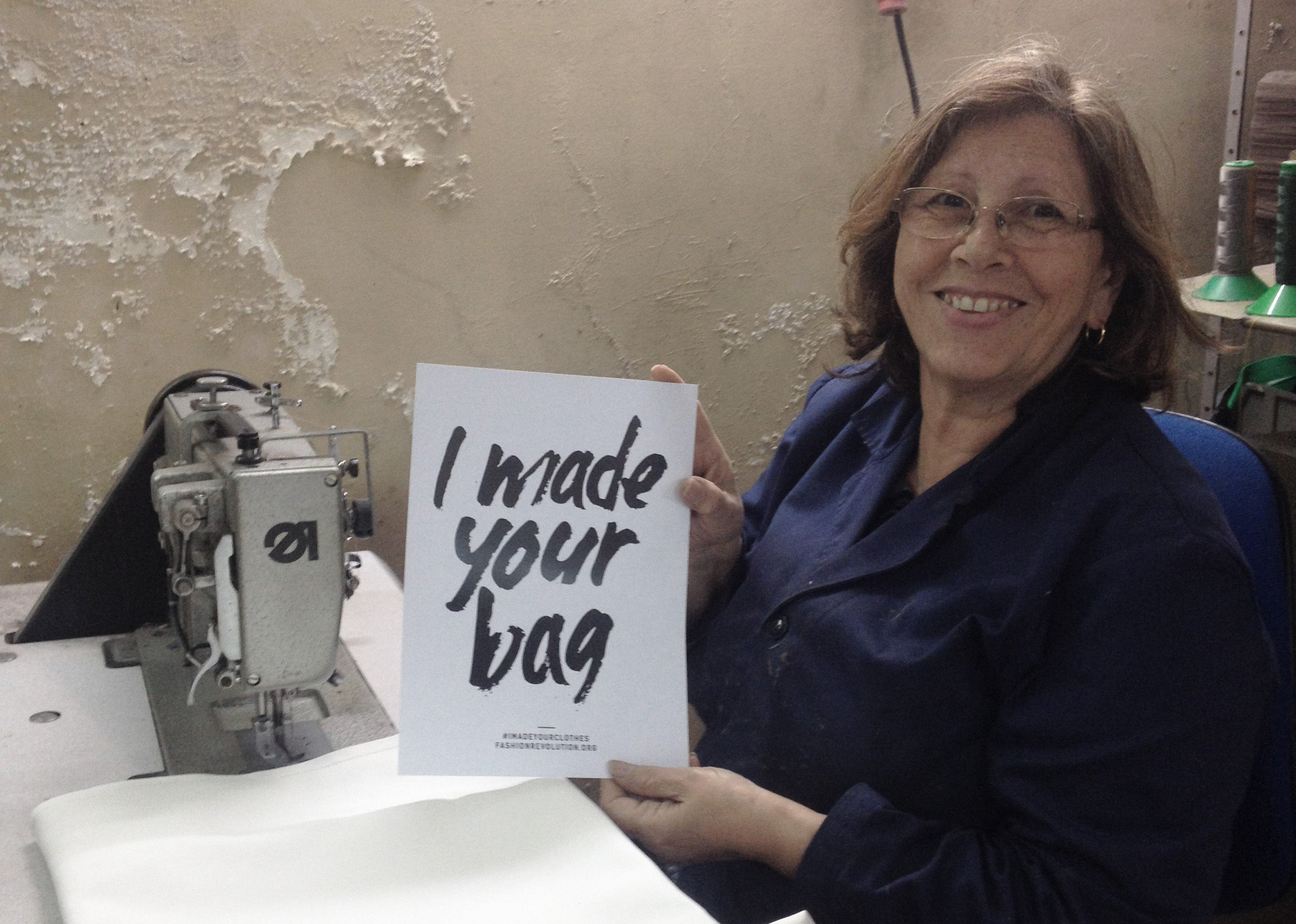 "Fernanda at her home studio holding the ""I made your bag"" statement phrase"
