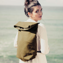 Load image into Gallery viewer, Girl with khaki green hemp backpack in the ocean