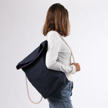 Load image into Gallery viewer, Girl in jeans with backpack in blue hemp canvas with off white rope strap