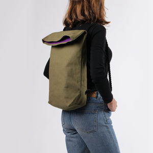 Girl in jeans with hemp backpack in khaki green