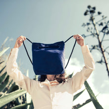 Load image into Gallery viewer, Girl holding blue hemp bag with cactus on background