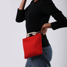 Load image into Gallery viewer, Girl in jeans with Beltbag in red hemp canvas with off white rope strap