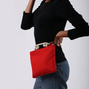 Girl in jeans with Beltbag in red hemp canvas with off white rope strap