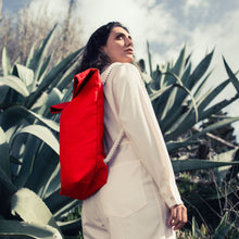 Load image into Gallery viewer, Girl with red hemp canvas backpack and cactus on the background