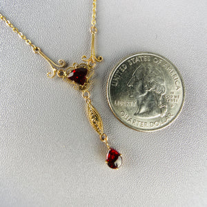 Garnet necklace in yellow gold