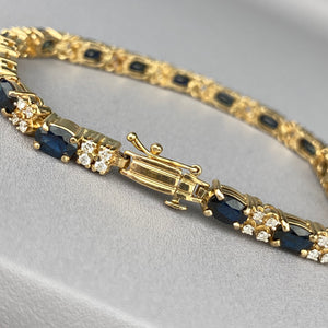 Sapphire and diamond tennis bracelet in yellow gold