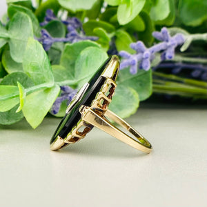Vintage large oval onyx and diamond ring in yellow gold