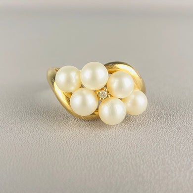 Vintage pearl and diamond ring in yellow gold