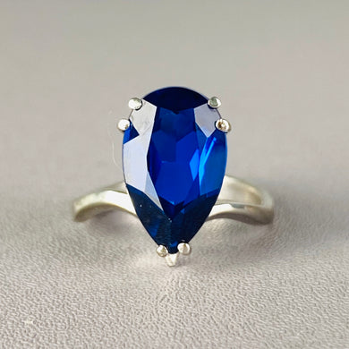 Bright pear shape blue spinel tiara ring