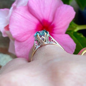 Blue zircon solitaire in yellow gold