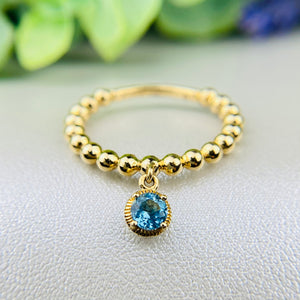 Beaded ring with blue topaz dangle by Effy in 14k yellow gold