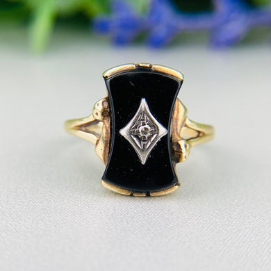Vintage shaped onyx and diamond ring in yellow gold