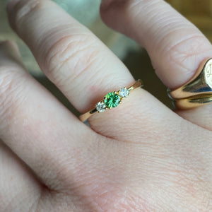 Tsavorite and diamond 3 stone ring in 14k