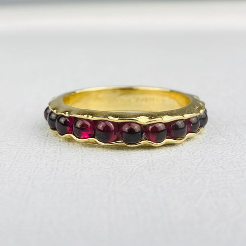 Garnet eternity band in 14k yellow gold