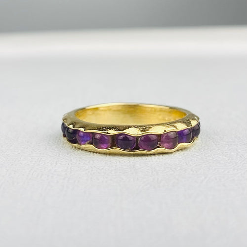 Amethyst eternity band in 14k yellow gold