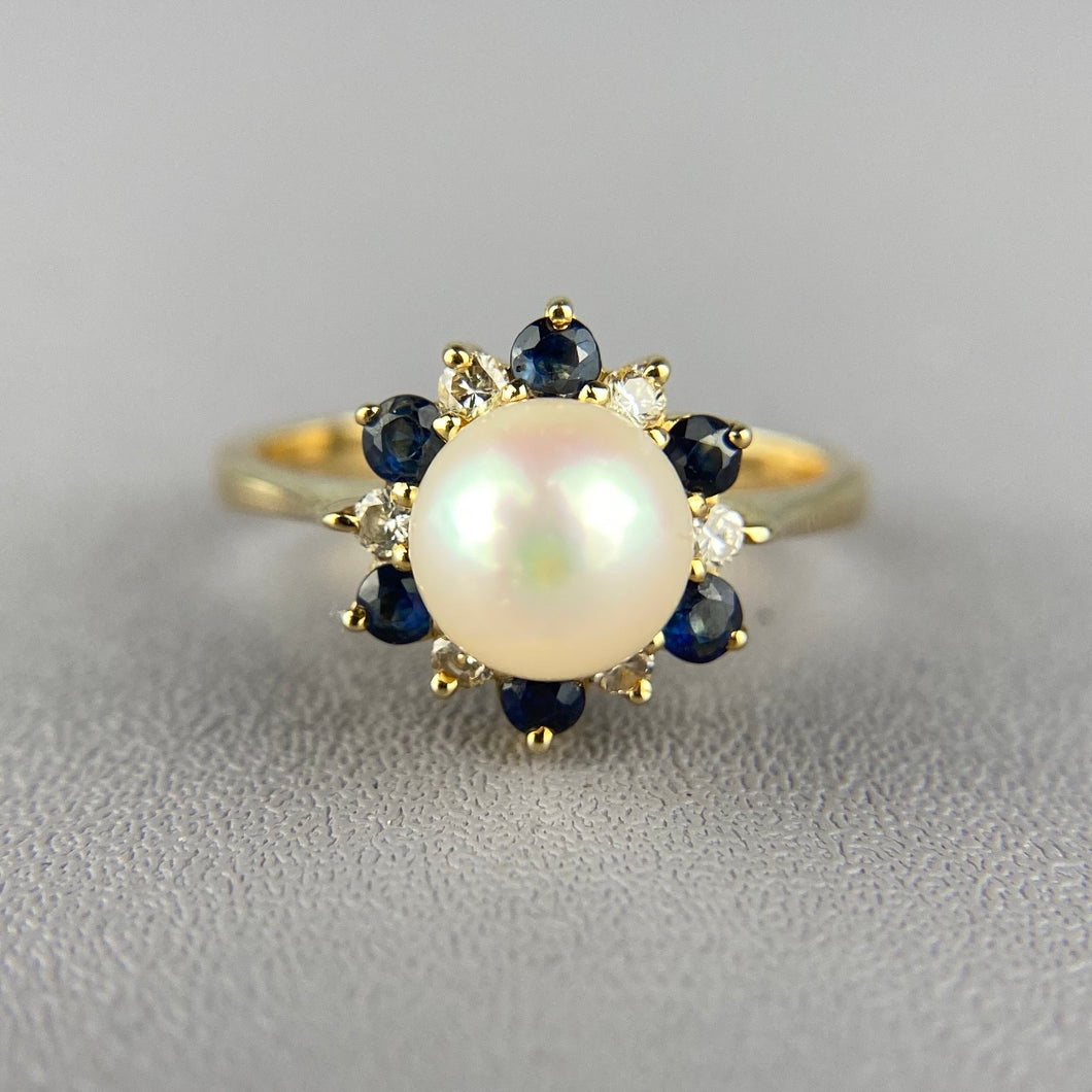 Pearl, sapphire, and diamond ring in yellow gold