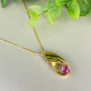 Pink sapphire necklace in 14k yellow gold
