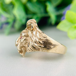 Lion's head ring in yellow gold with rubies and diamonds
