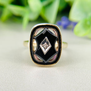 Vintage onyx and diamond ring in yellow gold