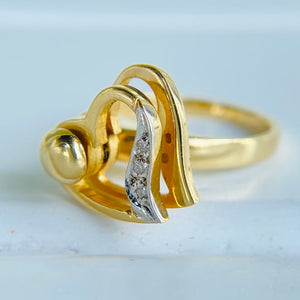 Spinning diamond heart ring  in 14k yellow gold