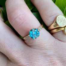 Load image into Gallery viewer, Blue zircon solitaire in yellow gold