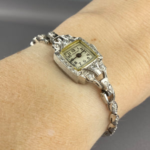 Platinum and 14k antique diamond watch