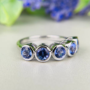 Tanzanite bezel set band in 14k white gold