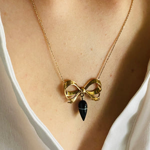 Banded agate bow necklace in yellow gold