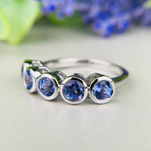 Load image into Gallery viewer, Tanzanite bezel set band in 14k white gold