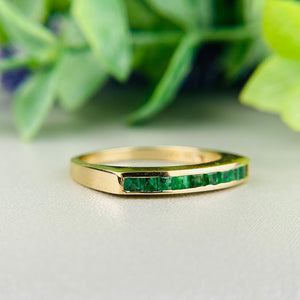 Emerald band in 14k yellow gold