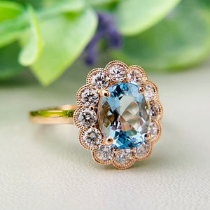 Aquamarine and Diamond halo ring in 18k rose gold